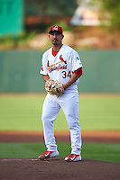 Springfield Cardinals pitcher Andrew Morales (34) gets ready to deliver a pitch during a game against the Frisco RoughRiders  on June 4, 2015 at Hammons Field in Springfield, Missouri.  Frisco defeated Springfield 8-7.  (Mike Janes/Four Seam Images)