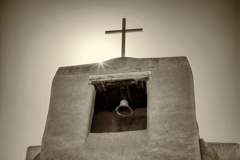 Cross and church bell. San Miguel Mission. Santa Fe, New Mexico.