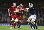 Wales lock Alun Wyn Jones hands off Richie Gray.<br /> RBS 6 Nations 2014<br /> Wales v Scotland<br /> Millennium Stadium<br /> <br /> 15.03.14<br /> <br /> ©Steve Pope-SPORTINGWALES