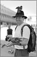 Man in St. Mark's Square with pigeons