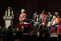 Pictured: (L-R) Professor Richard B Davies, Vice Chancellor for Swansea University gives a speech during the honorary degree award ceremony for Hillary Clinton at Swansea University Bay Campus. Saturday 14 October 2017<br /> Re: Hillary Clinton, the former US secretary of state and 2016 American presidential candidate will be presented with an honorary doctorate during a ceremony at Swansea University's Bay Campus in Wales, UK, to recognise her commitment to promoting the rights of families and children around the world.<br /> Mrs Clinton's great grandparents were from south Wales.