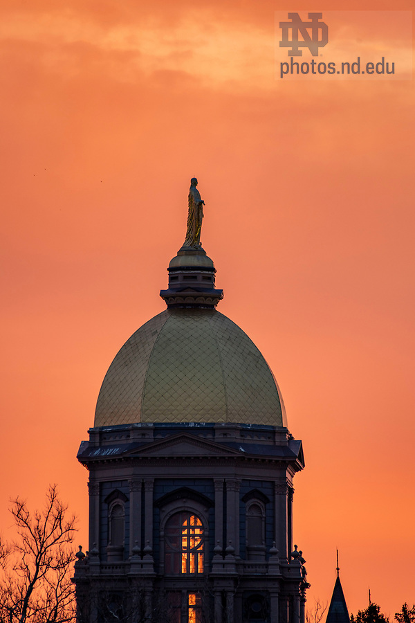 April 3, 2020; Main building at sunrise . (Photo by Barbara Johnston/University of Notre Dame)