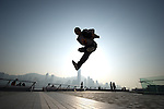 B-Boy Taisuke in action on Hong Kong's Victoria Harbour waterfront.