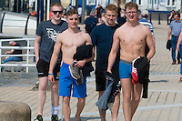 Aberystwyth Wales UK, Thursday 12 May 2016<br /> UK Weather: Young men walk by the beach at the seaside in  Aberystwyth,   on the Cardigan Bay coast of west Wales, enjoying a last day of warm weather in the current mini-heatwave. <br /> The temperatures are set to fall over the coming days, with bright but colder conditions prevailing over the country
