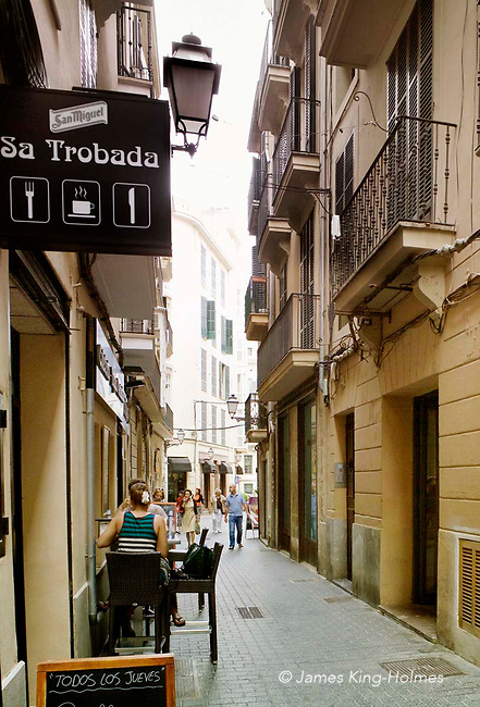 Carrer Paraires, one of the narrow shopping streets in central Palma, Majorca, Spain.