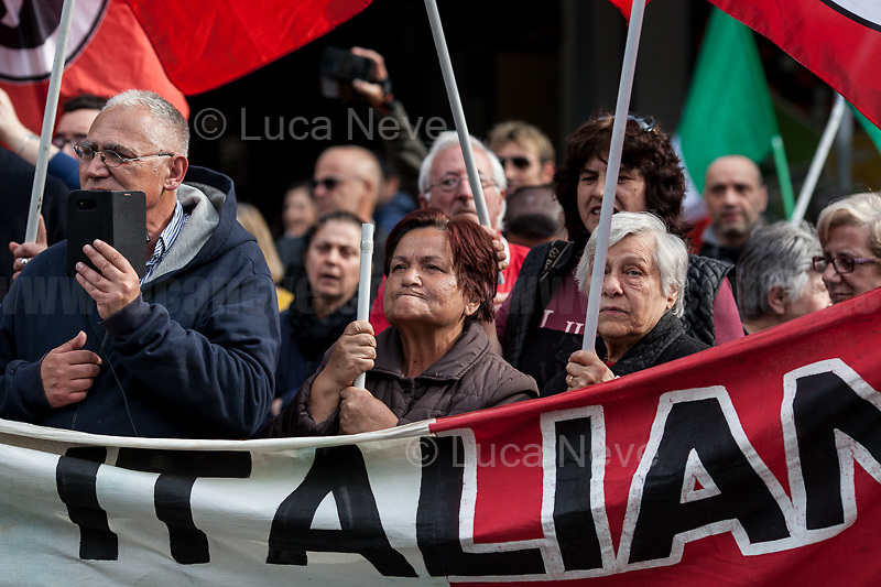 """fascists.<br /> <br /> Roma, 08/05/2019. Today, members of the far-right/neo-fascist political party 'casapound', held a rally in Casal Bruciato (suburb in the East side of Rome) in response to the allocation of a council flat to a Roma family - legally in the waiting list of Rome's Municipality - with twelve children and not any previous offenses committed. On the 7th of May a similar protest was held with the support of some residents of the district. Some members of the fascist organization 'casapound', undisputed by the police, insulted and menaced the Roma woman - while she was carrying her daughter in her arms - to """"rape"""" her, that she is a """"prostitute"""", and that all Roma people should be """"hanged"""".<br /> In the meantime, Anti-fascist / Anti-racist Organizations, Movements for Housing, social centres, members of the public, supported by trade unions and lefty political parties, held a counter-demonstration nearby. The demo was called to protest against the rally of """"casapound"""", accused to be a fascist group (illegal for the Italian Law so which needs to be immediately closed) - they call themselves """"fascists of the third millennium"""" - trying to fomenting hatred, pushing the people of the suburbs in a war between poor people, and to be just """"narrow-minded slander"""" ('sciacallaggio' in Italian).  <br /> The heavy police presence in full riot gears, supported by a water cannon truck and a helicopter, kept the two sides apart letting the Antifascist movements having a march in the district, once a historic """"Roccaforte Rossa"""" (a red stronghold)."""