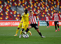 1st October 2020; Brentford Community Stadium, London, England; English Football League Cup, Carabao Cup Football, Brentford FC versus Fulham; Marcus Forss of Brentford challenges Jean Michaël Seri of Fulham