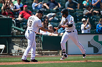 Sacramento RiverCats first baseman Myles Schroder (9) is congratulated by third base coach Nestor Rojas (18) after hitting a home run during a Pacific Coast League against the Tacoma Rainiers at Raley Field on May 15, 2018 in Sacramento, California. Tacoma defeated Sacramento 8-5. (Zachary Lucy/Four Seam Images)