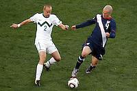 Miso Brecko (L) of Slovenia and Michael Bradley (R) of USA