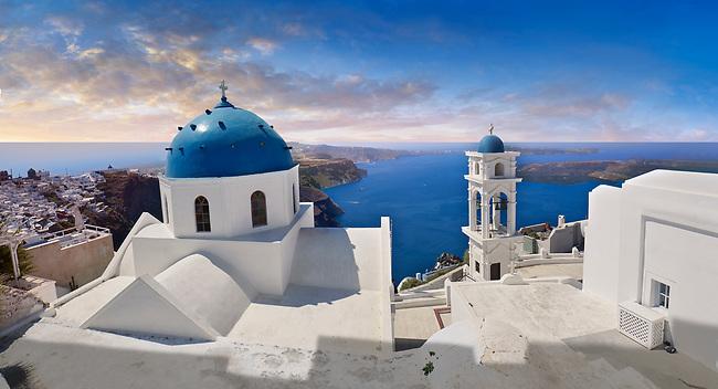 Traditional blue domed Greek Orthodox church of Imerovigli, Island of Thira, Santorini, Greece.