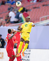 CLEVELAND, OH - JUNE 22: Torell Ondaan #17 heads the ball over Eric Davis #15 and Alberto Quintero #19 during a game between Panama and Guyana at FirstEnergy Stadium on June 22, 2019 in Cleveland, Ohio.