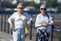 Pictured: Two ladies enjoying a walk during the sunny weather at Mumbles, near Swansea, Wales, UK. Thursday 19 September 2019