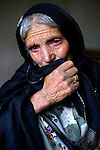 Masura's eyes are red from weeping as she mourns her husband who died of illness just days before in Farghamanch, Jurm district, Badakhshan province, Afghanistan, Friday afternoon, Oct. 23, 2009. Many remote areas in Afghanistan, especially in poorer provinces like Badakhshan, still lack enough water, electricity, schools and health clinics. As the Obama Administration seeks the formula for turning the tide of the war in Afghanistan, some aid organizations are advocating the National Solidarity Programme, a community-based development program that has made progress in some districts, setting up local councils that propose much-needed projects such as schools, drinking water facilities and roads.