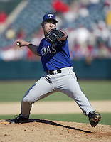 Rudy Seanez of the Texas Rangers pitches during a 2002 MLB season game against the Los Angeles Angels at Angel Stadium, in Los Angeles, California. (Larry Goren/Four Seam Images via AP Images)