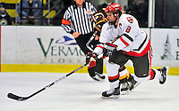 2 January 2009: St. Lawrence Saints' defenseman and Team Co-Captain Jared Ross, a Senior from Stony Island, Nova Scotia, in action against the Ferris State Bulldogs in the first game of the 2009 Catamount Cup Ice Hockey Tournament hosted by the University of Vermont at Gutterson Fieldhouse in Burlington, Vermont. The Saints defeated the Bulldogs 5-4 to move onto the championship game against the University of Vermont Catamounts...Mandatory Photo Credit: Ed Wolfstein Photo