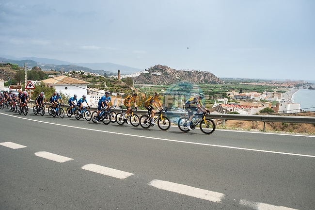 The peloton led by Jumbo-Visma along the coast during Stage 10 of La Vuelta d'Espana 2021, running 189km from Roquetas de Mar to Rincón de la Victoria, Spain. 24th August 2021.     <br /> Picture: Cxcling | Cyclefile<br /> <br /> All photos usage must carry mandatory copyright credit (© Cyclefile | Cxcling)