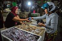 Bali, Indonesia.  Buying Shrimp, Jimbaran Fish Market.