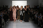 """Fashion designer Erin Fetherston walks with models for the close of her Erin Fetherston Fall 2017 """"In Pursuit of Rhapsody"""" collection fashion show, at Skylight Clarkson Square on February 9, 2017 at New York Fashion Week: The Shows."""