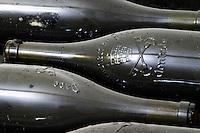 pile of bottles bottle with moulded relief on the neck domaine du vieux lazaret chateauneuf du pape rhone france