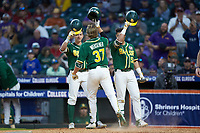 Chase Wehsener (37) of the Baylor Bears celebrates at home plate with teammates Esteban Cardoza-Oquendo (52) and Jared McKenzie (18) after hitting a home run against the LSU Tigers in game five of the 2020 Shriners Hospitals for Children College Classic at Minute Maid Park on February 29, 2020 in Houston, Texas. The Bears defeated the Tigers 6-4. (Brian Westerholt/Four Seam Images)
