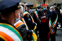 NEW YORK, NEW YORK - MARCH 17: The Cardinal Timothy Dolan (2R) talks people attending St. Patrick's Day parade on March 17, 2021 in New York. St. Patrick's Day Parade organizers say they postpone the celebration, but a small group marched to preserve the tradition. (Photo by John Smith/VIEWpress)