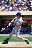 OAKLAND, CA:  Carlos Beltran of the Kansas City Royals bats during a game against the Oakland Athletics at the Oakland Coliseum in Oakland, California in 1998. (Photo by Brad Mangin)