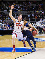 March 21st, 2013: California's Justin Cobbs is being defended by UNLV's Katin Reinhardt during a game at HP Pavilion, San Jose, California. California defeated UNLV 64 - 61
