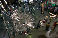 A bullet hole through a window pane at Chhatrapati Shivaji Terminus after multiple terrorist attacks were launched in Mumbai on 26/11/2008. The train station, formerly Victoria Terminus and better known as CST or Bombay VT, was one of the targets.