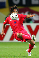 Jung Hwan Ahn of the Korea Republic hooks the ball over his head. The Korea Republic and France played to a 1-1 tie in their FIFA World Cup Group G match at the Zentralstadion, Leipzig, Germany, June 18, 2006.