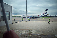 Nigeria. Enugu State. Enugu Airport. Akanu Ibiam International Airport, also known as Enugu Airport. Domestic Terminal. A Boeing 737 Classic from Air Peace has just landed on the tarmac. Staff men wearing green safety vest. Air Peace is a private Nigerian airline founded in 2013. It provides passenger and charter services to the major cities of Nigeria. 15.07.19 © 2019 Didier Ruef