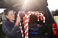 FARM'S FA-LA-LA<br /> Katie Templin unloads Christmas decorations on Tuesday Nov. 17 2020 to get War Eagle Mills Farm in east Benton County decked out for the holidays. The farm is the site of the War Eagle Fair arts and crafts event held each October. The fair was held online this year. Plans are to put decorations soon on the historic War Eagle bridge that spans the War Eagle River adjacent to the farm, Templin said. Go to nwaonline.com/201118Daily/ to see more photos. <br /> (NWA Democrat-Gazette/Flip Putthoff)