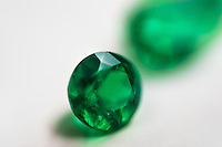 A fine round-shaped emerald, having a value of $5,000-10,000, is seen in the jewelry workshop in Bogota, Colombia, 8 February 2014. Around 60% of the world's emerald production come from Colombia. Most of the gemstones are cut, faceted and processed into jewelry in the workshops located in the emerald district in downtown Bogota. There are approximately 2000 jewelers working in the emerald district. Due to their special clarity and deep vivid green color, Colombian emeralds are considered the most beautiful in the world.