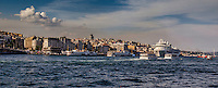 Fine Art Print Photograph. <br /> The Bosphorus strait in Istanbul, Turkey. <br /> The golden rays of the setting sun add warmth and texture to the buildings and waterway of the Bosphorus.<br /> The golden sky background adds contrast, and brings out the beautiful architectural lines of the buildings and ships.