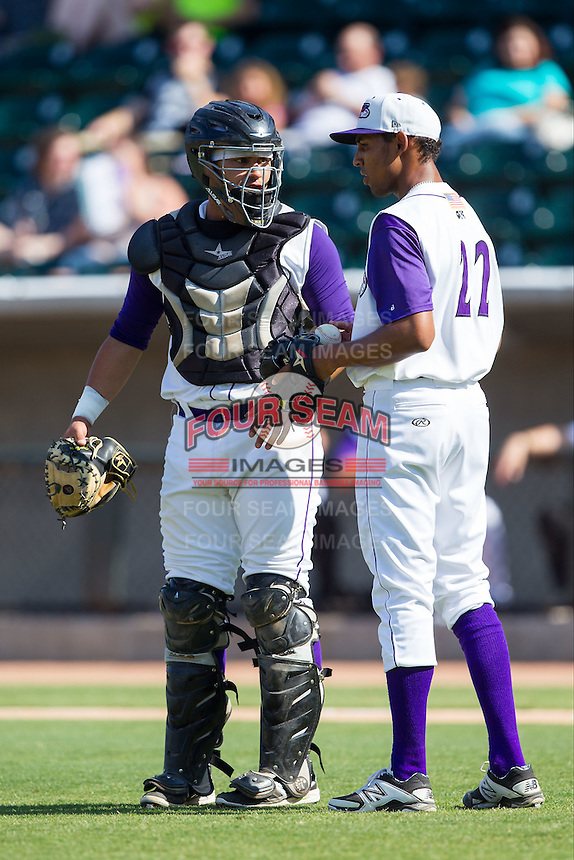 Winston-Salem Dash catcher Omar Narvaez (21) has a chat with starting pitcher Angel Sanchez (22) during the game against the Wilmington Blue Rocks at BB&T Ballpark on July 6, 2014 in Winston-Salem, North Carolina.  The Dash defeated the Blue Rocks 7-1.   (Brian Westerholt/Four Seam Images)