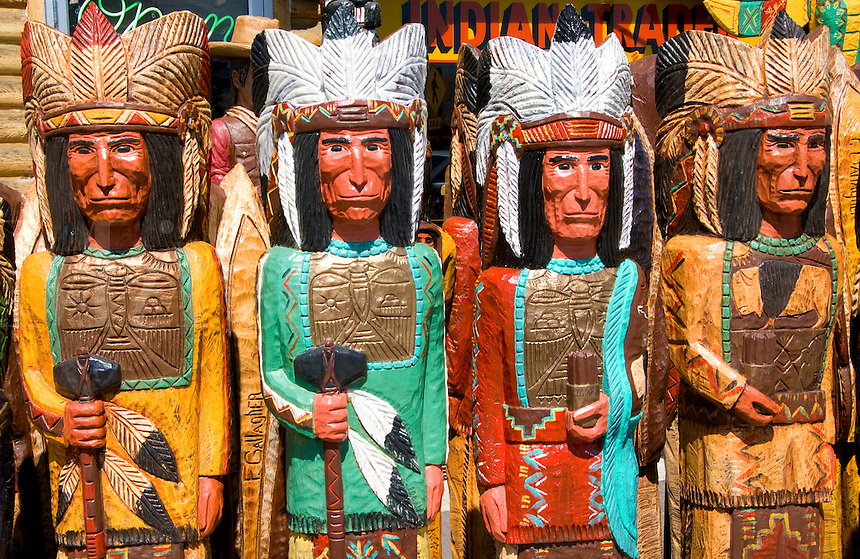 Old fashioned cigar store, Indian totem pole statues in Jackson Hole, Wyoming, USA