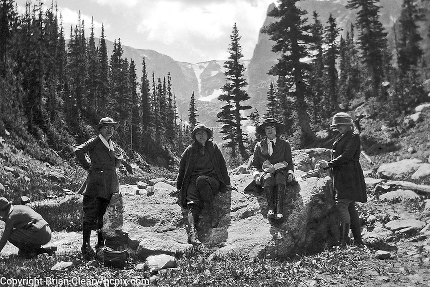 Four women seated on a boulder in western United States, circa 1930's.   (photo: www.bcpix.com)
