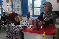 TUNISIA - OCTOBER 6: Tunisians cast their vote at a polling station during the parliamentary elections in Ben Arous, Tunisia on October 6, 2019