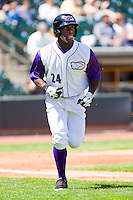 Jared Mitchell #24 of the Winston-Salem Dash hustles down the first base line against the Kinston Indians at BB&T Ballpark on April 17, 2011 in Winston-Salem, North Carolina.   Photo by Brian Westerholt / Four Seam Images