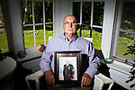 May 9, 2009. Tryon, NC.. In the last weeks of their deployment in Iraq, the 1451st Transportation Company of the NC National Guard lost 2 men to an IED explosion. After returning home, 4 of the surviving soldiers took their own lives.. Lawrence Parker is the father of 1st Sergeant Roger Parker, who served in Iraq with the 1451st Transportation Company of the NC National Guard when they lost 2 men to a roadside bomb. After returning from Iraq, 1st Sgt. Parker committed suicide, leaving behind a wife and his father and sister.  Mr. Parker holds a photo of his son.