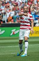 SANDY, UT - July 13, 2013: US Mens National Team forward Landon Donovan (10) celebrates his goal during the USA vs Cuba match at Rio Tinto Stadium in Sandy, Utah. Final score USA 4, Cuba 1.