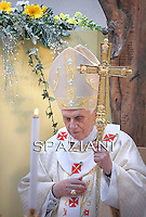Pope Benedict XVI celebrates mass during his pastoral visit to St. Corbiniano Parish in Rome on March 20, 2011.