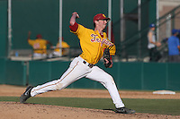 Brooks Kriske #23 of the USC Trojans pitches against the Northwestern Wildcats at Dedeaux Field on  February 16, 2014 in Los Angeles, California. USC defeated Northwestern, 13-6. (Larry Goren/Four Seam Images)