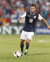 USMNT forward Chris Wondolowski (19) crosses the ball.  In CONCACAF Gold Cup Group Stage, the U.S. Men's National Team (USMNT) (blue/white) defeated Costa Rica (red/blue), 1-0, at Rentschler Field, East Hartford, CT on July 16, 2013.