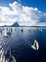 Yachts racing in the second leg of the Tahiti Pearl Regatta, from Bora Bora to Tahaa