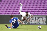 Orlando, Florida - Saturday January 13, 2018: Francis Atuahene is tripped by Tomas Hillard-Arce. Match Day 1 of the 2018 adidas MLS Player Combine was held Orlando City Stadium.