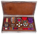 2004.33.1-9<br /> The Great War Citations of T. Edward Hambleton. American Expeditionary Forces. United States Army. Case with medals. <br /> World War I.<br /> Ca. 1917-1923.<br /> Silver<br /> Maker unknown<br /> 5.5 x 9 x 1 inches<br /> Museum Department