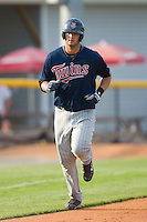 Michael Gonzales #32 of the Elizabethton Twins jogs home after hitting a grand slam in the third inning at Burlington Athletic Park July 19, 2009 in Burlington, North Carolina. (Photo by Brian Westerholt / Four Seam Images)