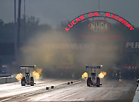 Aug 30, 2014; Clermont, IN, USA; NHRA top fuel dragster driver Spencer Massey (right) races alongside J.R. Todd during qualifying for the US Nationals at Lucas Oil Raceway. Mandatory Credit: Mark J. Rebilas-USA TODAY Sports
