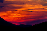 A setting sun burns the sky red over the mountains surrounding Butler, Tennessee.