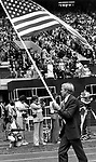 United States Olympian carries American flag in the opening of the 1976 Summer Olympics Montreal Canada Queen  Elizabeth in stands,